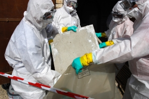 Asbestos Remediation - The professional ACM Removal team works together to remove contained asbestos.